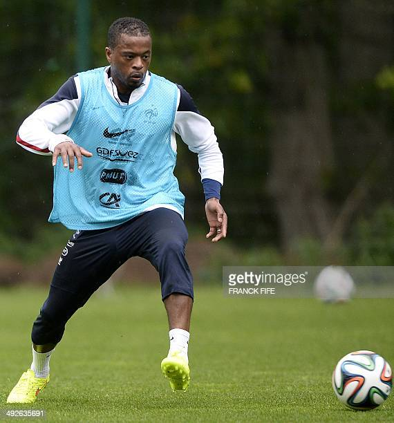 French National football team's defender Patrice Evra controls the ball during a training session in ClairefontaineenYvelines outside Paris on May 21...