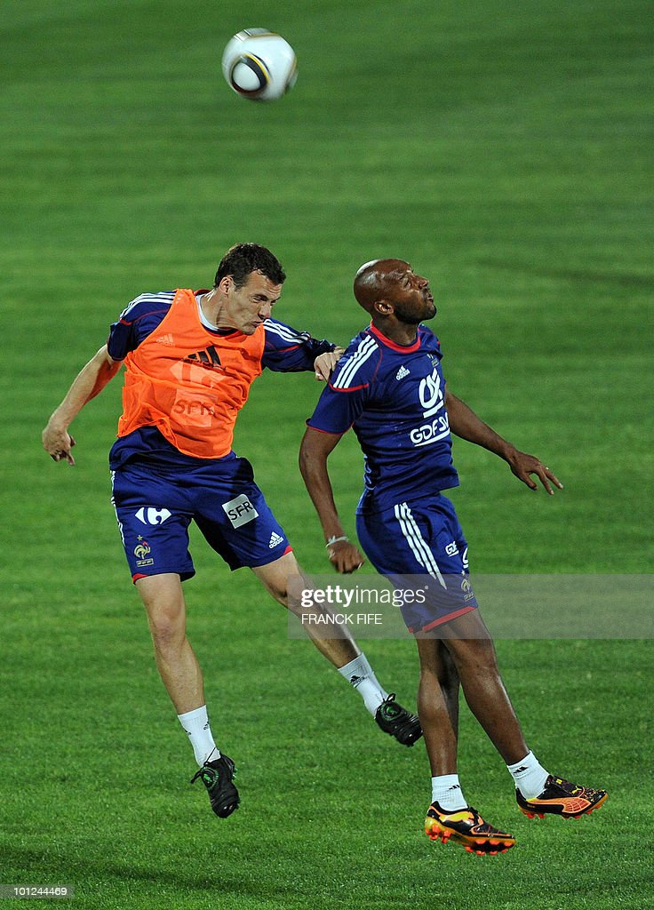 French national football team's defender Sebastien Squillaci (L) vies for the ball with Nicolas Anelka during a training session, on May 28, 2010, in Sousse, as part of the preparation for the upcoming World Cup 2010. France will play against Uruguay in Capetown in its group A opener match on June 11.