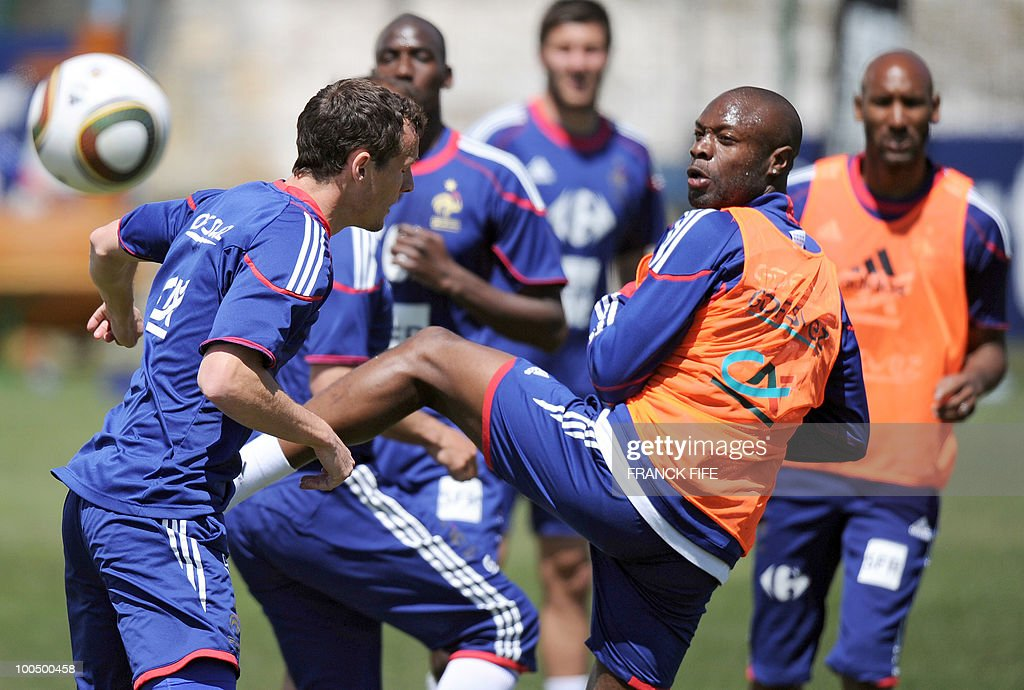 French national football team's defender Sebastien Squillaci (L) vies with teammate, defender William Gallas during a training session, on May 25, 2010, near Tignes in the French Alps, as part of the preparation for the upcoming World Cup 2010. France will play against Uruguay in Capetown in its group A opener match on June 11.
