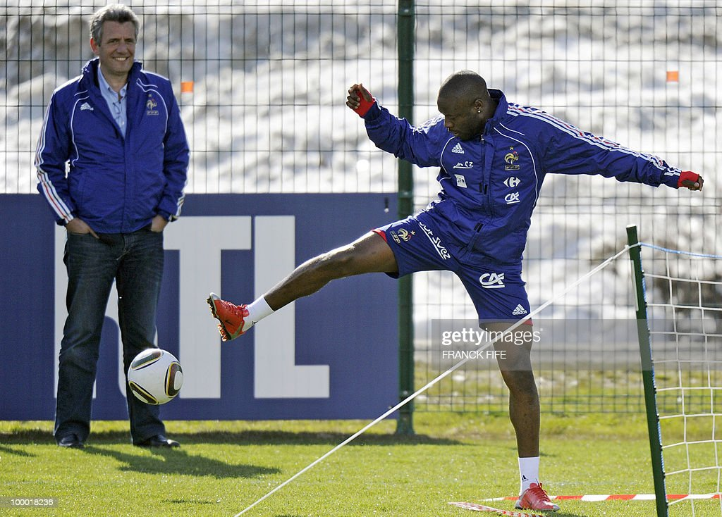 French national football team's defender William Gallas (R) controls the ball next to French national coach handball, Claude Onesta (L) during a training session, on May 20, 2010 in Tignes, French Alps, as part of their altitude training in preparation for the 2010 World cup in South Africa. France will play Uruguay in Capetown in its group A opener match on June 11.