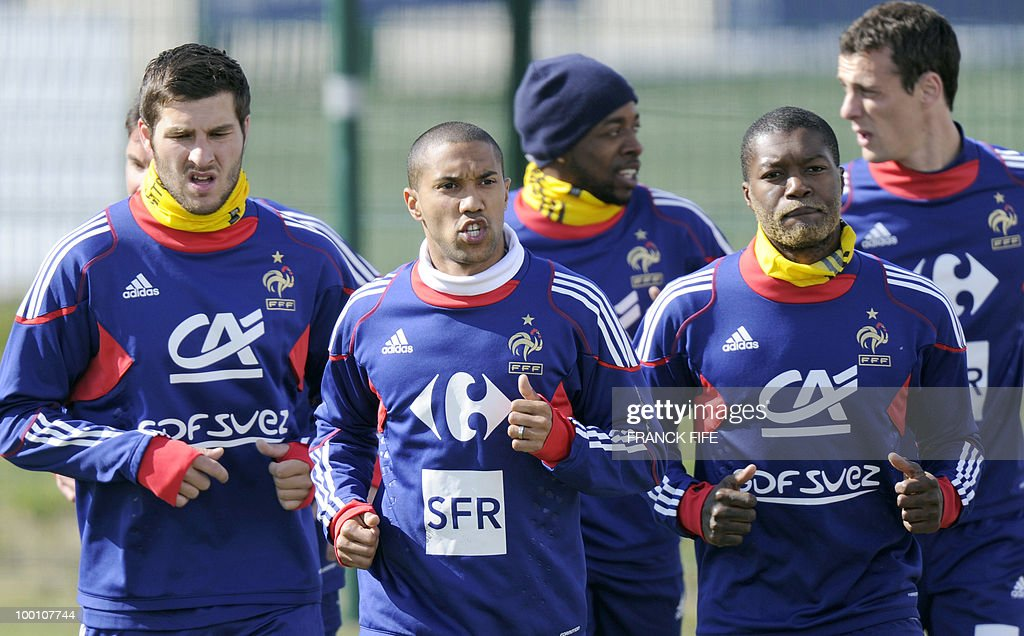 French national football team's forward Andre-Pierre Gignac, defender Gael Clichy and forward Djibrill Cisse, run during a training session, on May 20, 2010 in Tignes, French Alps, as part of their altitude training in preparation for the 2010 World cup in South Africa. France will play Uruguay in Capetown in its group A opener match on June 11. Some of the players wear a yellow bandana, that their sponsor will sell from May 21, 2010. The benefits will go to Nelson Mandela's 46664 Foundation.
