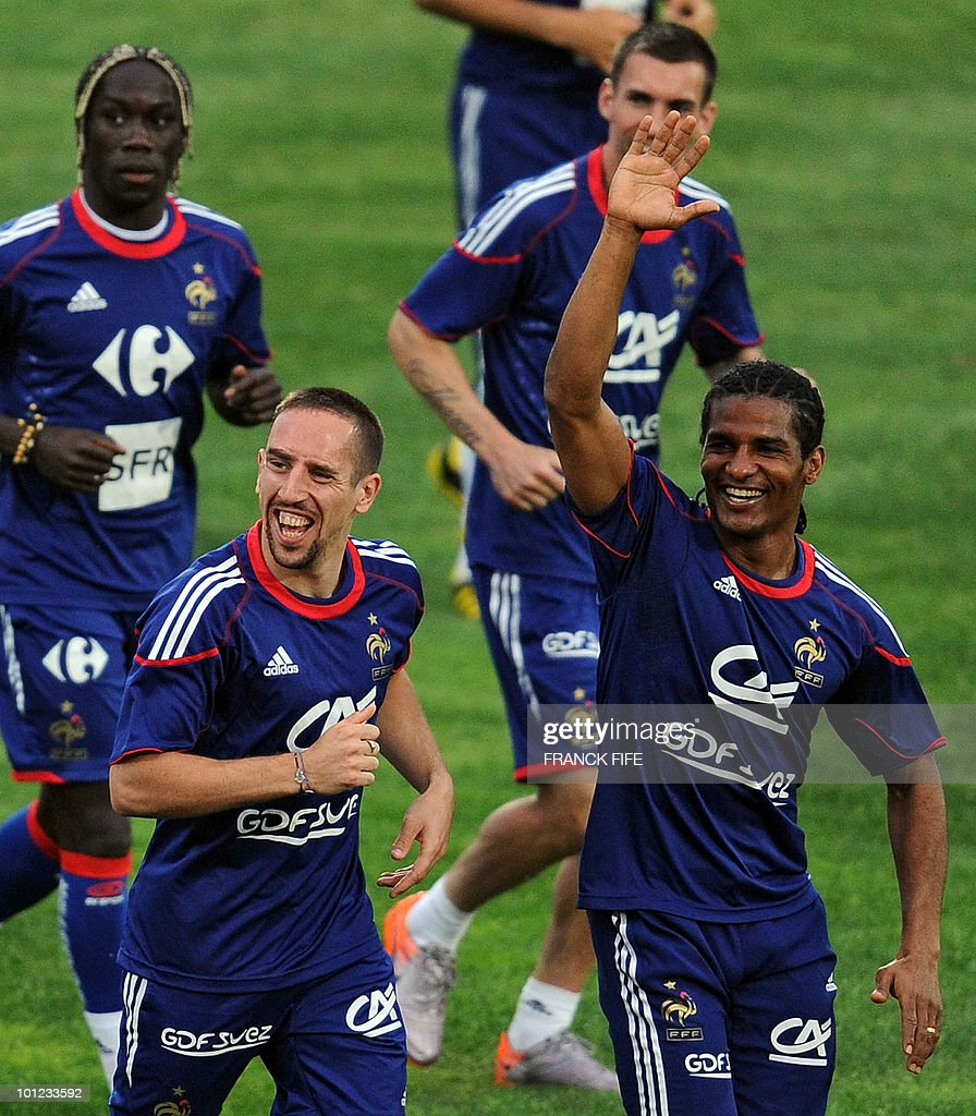 French national football team's forward Franck Ribery(C) and Florent Malouda run during a training session, on May 28, 2010, in Sousse, as part of the preparation for the upcoming World Cup 2010. France will play against Uruguay in Capetown in its group A opener match on June 11.