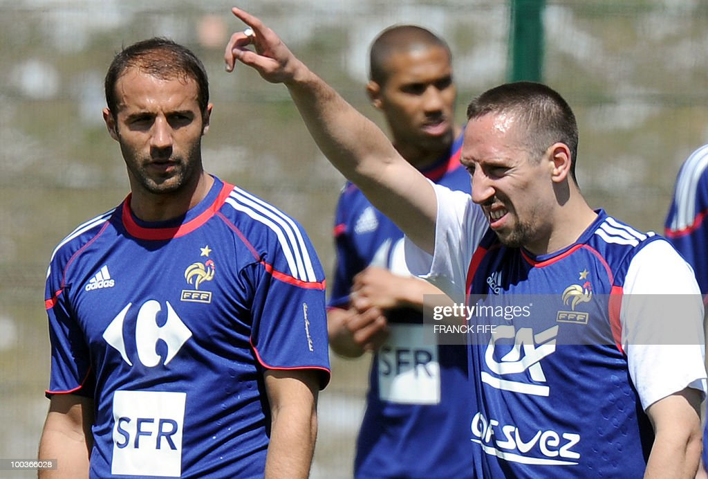 French national football team's forward Franck Ribery (R) gestures next to defender Marc Planus (L) during a training session, on May 24, 2010, near Tignes in the French Alps, as part of the preparation for the upcoming World Cup 2010. France will play against Uruguay in Capetown in its group A opener match on June 11.