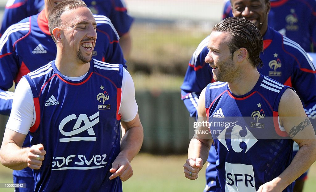 French national football team's forward Franck Ribery (L) shares a laugh with teammate Mathieu Valbuena (R) warm up during a training session, on May 25, 2010, near Tignes in the French Alps, as part of the preparation for the upcoming World Cup 2010. France will play against Uruguay in Capetown in its group A opener match on June 11.