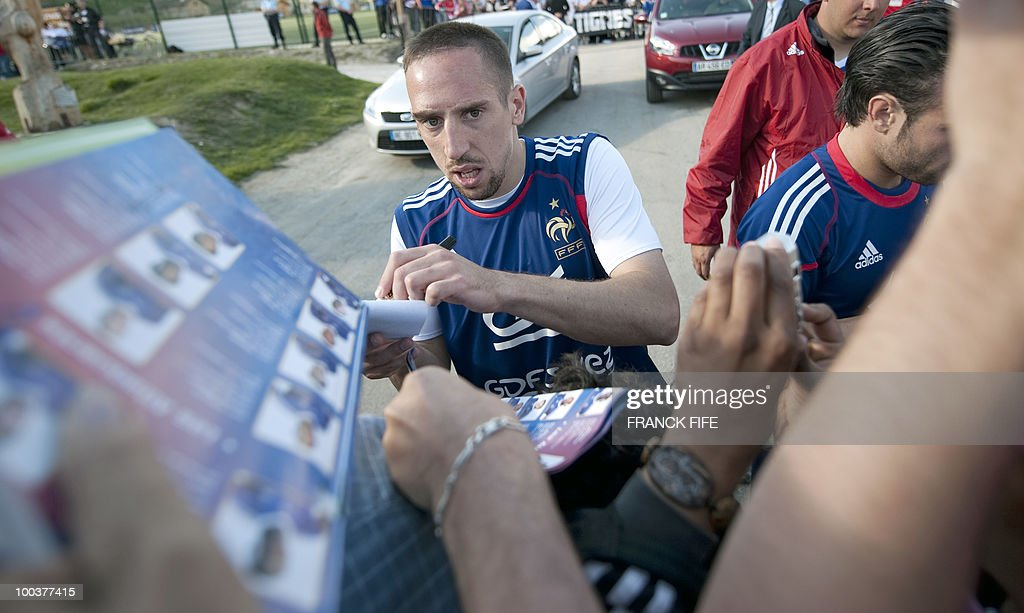 French national football team's forward Franck Ribery (C) signs a autographs after a training session, on May 24, 2010, near Tignes in the French Alps, as part of the preparation for the upcoming World Cup 2010. France will play against Uruguay in Capetown in its group A opener match on June 11.