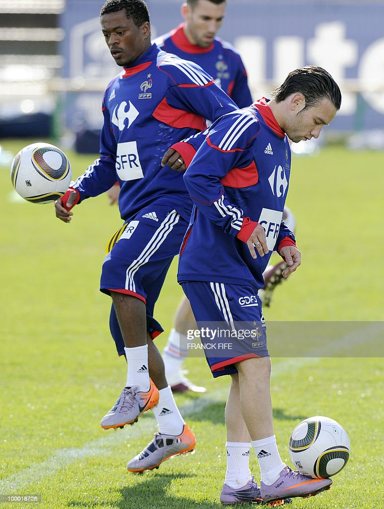 French national football team's forward Mathieu Valbuena (R) juggles with a ball next to defender Patrice Evra (L) during a training session, on May 20, 2010 in Tignes, French Alps, as part of their altitude training in preparation for the 2010 World cup in South Africa. France will play Uruguay in Capetown in its group A opener match on June 11.