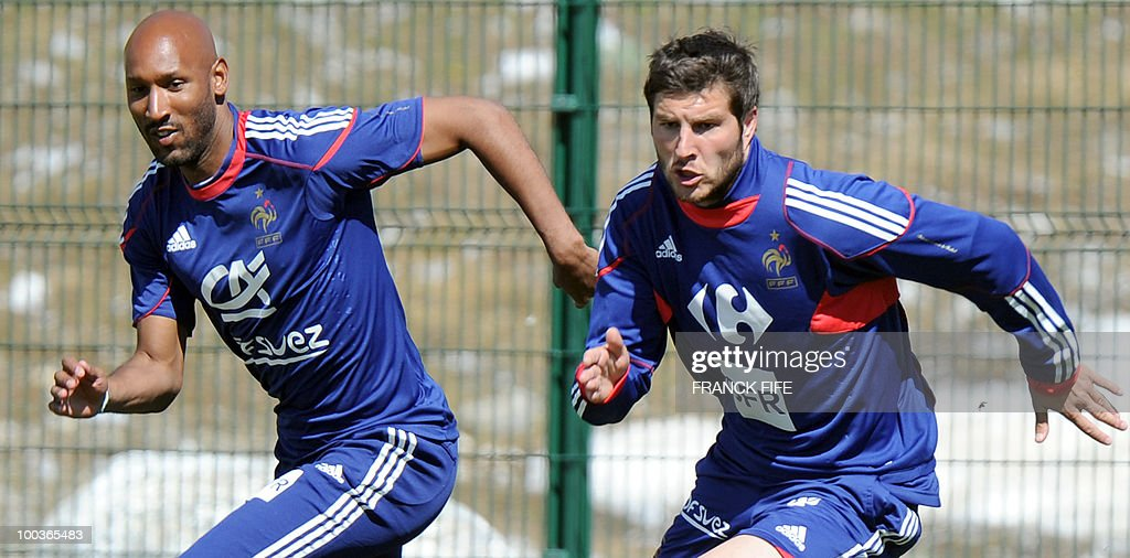 French national football team's forward Nicolas Anelka (L) and Andre-Pierre Gignac run during a training session, on May 24, 2010, near Tignes in the French Alps, as part of the preparation for the upcoming World Cup 2010. France will play against Uruguay in Capetown in its group A opener match on June 11.
