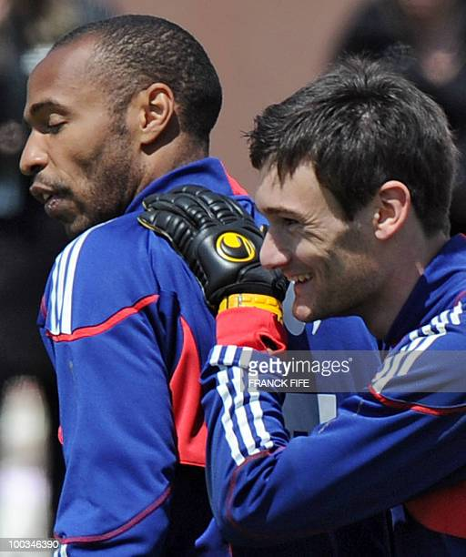 French national football team's forward Thierry Henry and Hugo Lloris smile at the end of training session on May 23 in Tignes in the French Alps as...