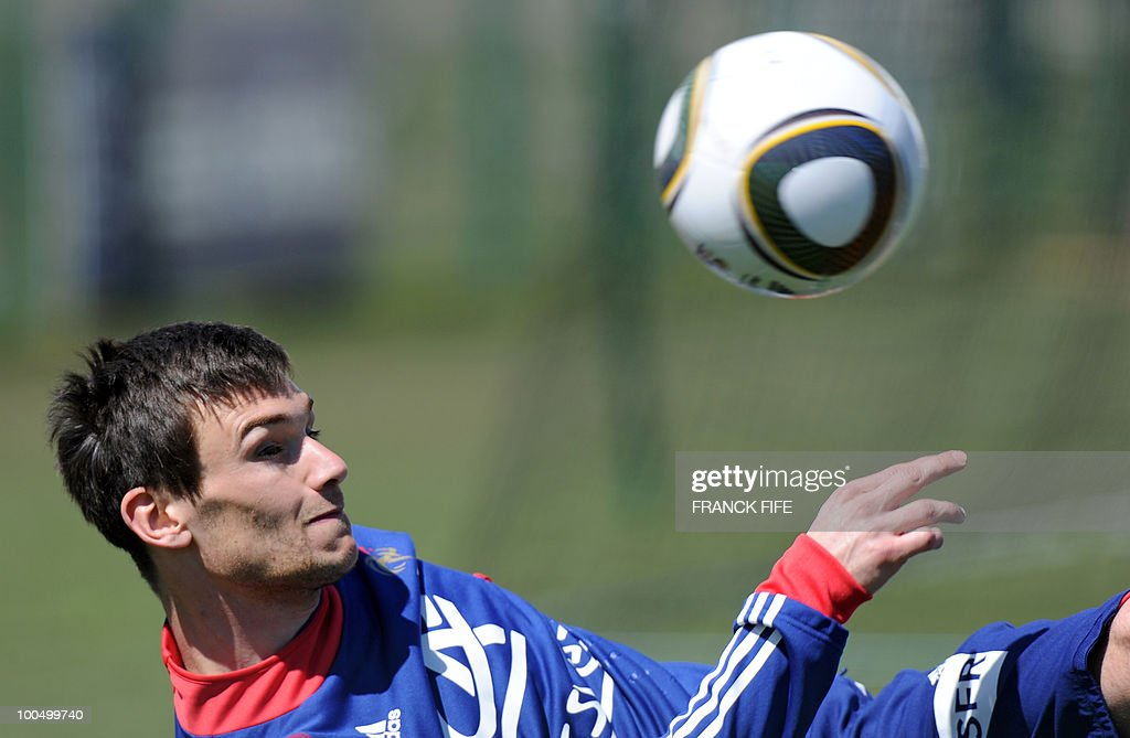 French national football team's goalkeeper Hugo Lloris eyes the ball during a training session, on May 24, 2010, near Tignes in the French Alps, as part of the preparation for the upcoming World Cup 2010. France will play against Uruguay in Capetown in its group A opener match on June 11.