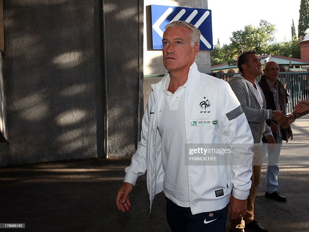 French national football team's head coach Didier Deschamps arrives for a press conference on September 5, 2013, on the eve of their FIFA World Cup 2014 qualifying football match Georgia vs France at the Boris Paichadze stadium in Tbilisi. AFP PHOTO / FRANCK FIFE