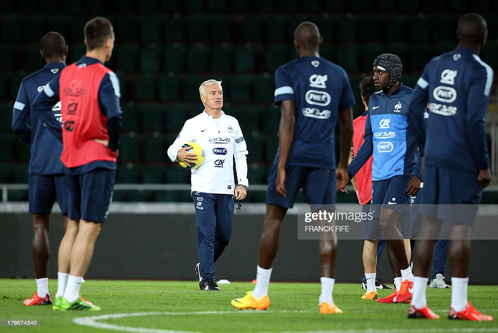 French national football team's head coach Didier Deschamps (C) gives instructions to his players during a training session on September 5, 2013, on the eve of their FIFA World Cup 2014 qualifying football match Georgia vs France at the Boris Paichadze stadium in Tbilisi.
