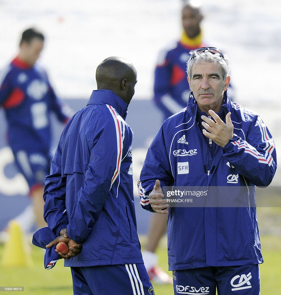 French national football team's midfielder Lassana Diarra (L) speaks with French coach Raymond Domenech during a training session, on May 20, 2010 in Tignes, French Alps, as part of their altitude training in preparation for the 2010 World cup in South Africa. France will play Uruguay in Capetown in its group A opener match on June 11.