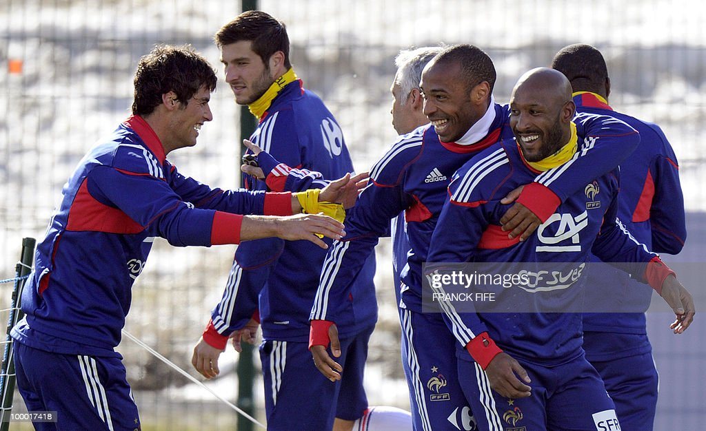 French national football team's midfielder Yoann Gourcuff (L) jokes with French national football team's captain Thierry Henry (2ndR) and forward Nicolas Anelka (R) during a training session, on May 20, 2010 in Tignes, French Alps, as part of their altitude training in preparation for the 2010 World cup in South Africa. France will play Uruguay in Capetown in its group A opener match on June 11.