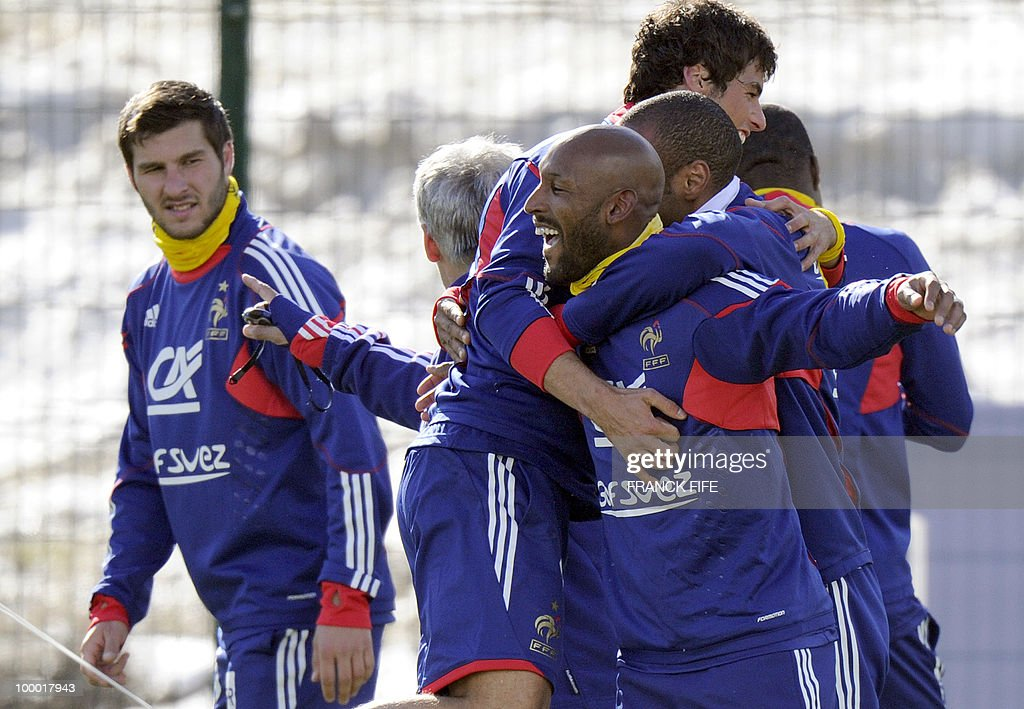 French national football team's midfielder Yoann Gourcuff (C) jokes with captain Thierry Henry (R) and Nicolas Anelka (2ndR), next to Andre-Pierre Gignac (L) during a training session, on May 20 , 2010 in Tignes, French Alps, as part of their altitude training in preparation for the 2010 World cup in South Africa. France will play Uruguay in Capetown in its group A opener match on June 11.