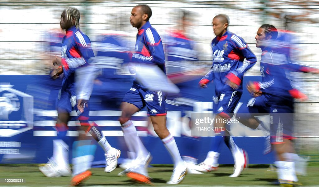 French national football team's players Bakary Sagna, Thierry Henry, Gael Clichy and Florent Malouda run during a training session, on May 24, 2010, near Tignes in the French Alps, as part of the preparation for the upcoming World Cup 2010. France will play against Uruguay in Capetown in its group A opener match on June 11.