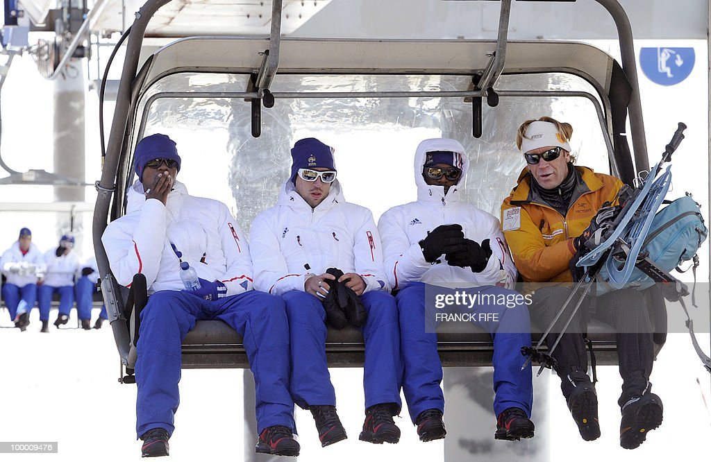 French national football team's players Eric Abidal, Franck Ribery, Patrice Evra and mountain guide sit on a ski lift upon their arrival in Tignes, French Alps, on May 20, 2010 after having spent the night with teammates at the top of the Tignes glacier, as part of their altitude training in preparation for the 2010 World cup in South Africa.