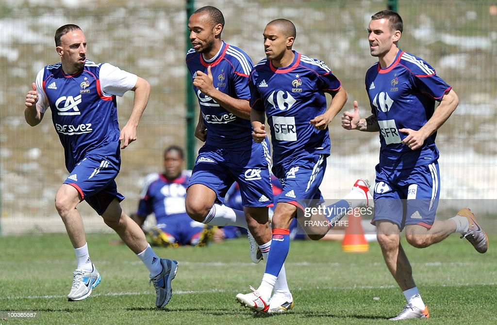 French national football team's players Franck Ribery, Thierry Henry, Gael Clichy and Anthony Reveillere run during a training session, on May 24, 2010, near Tignes in the French Alps, as part of the preparation for the upcoming World Cup 2010. France will play against Uruguay in Capetown in its group A opener match on June 11.
