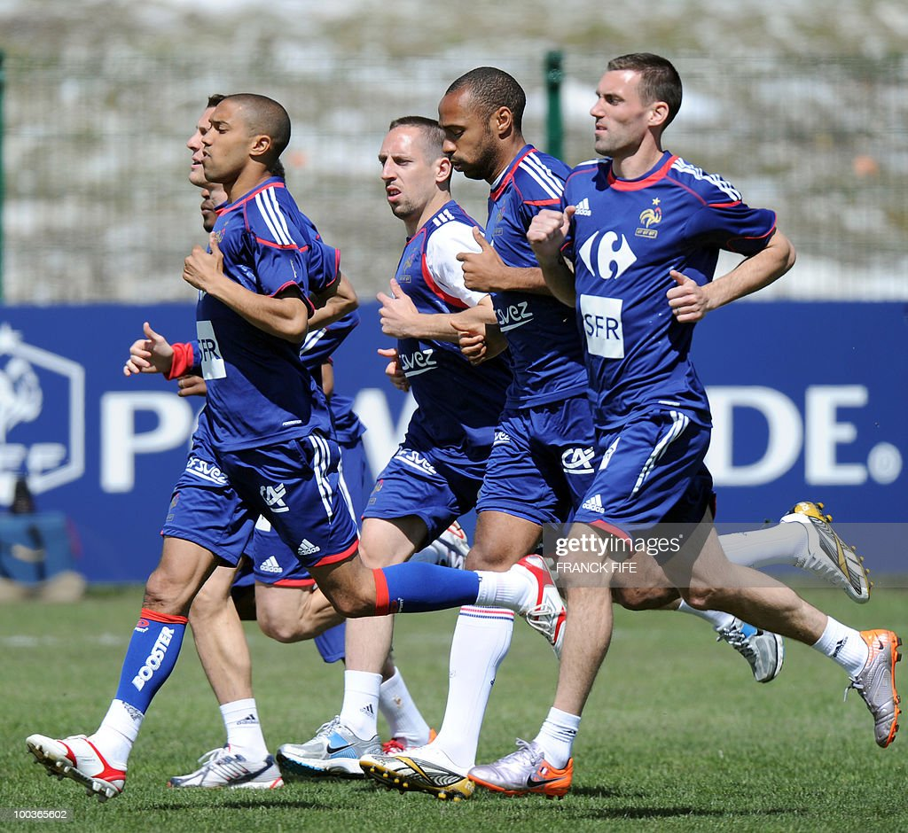 French national football team's players Gael Clichy, Franck Ribery, Thierry Henry and Anthony Reveillere run during a training session, on May 24, 2010, near Tignes in the French Alps, as part of the preparation for the upcoming World Cup 2010. France will play against Uruguay in Capetown in its group A opener match on June 11.