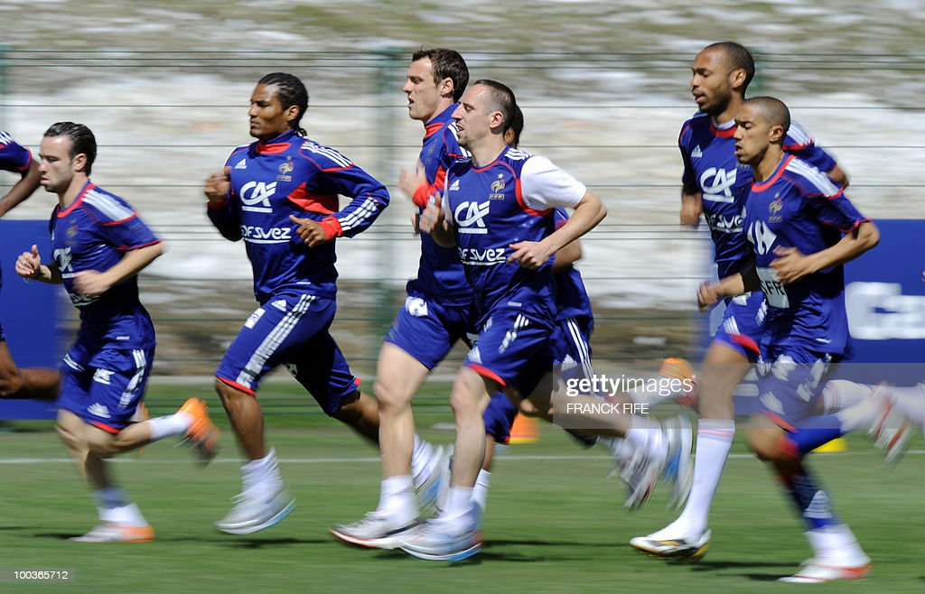 French national football team's players Mathieu Valbuena, Florent Malouda, Sebastien Squillaci, Franck Ribery, Thierry Henry and Gael Clichy run during a training session, on May 24, 2010, near Tignes in the French Alps, as part of the preparation for the upcoming World Cup 2010. France will play against Uruguay in Capetown in its group A opener match on June 11.