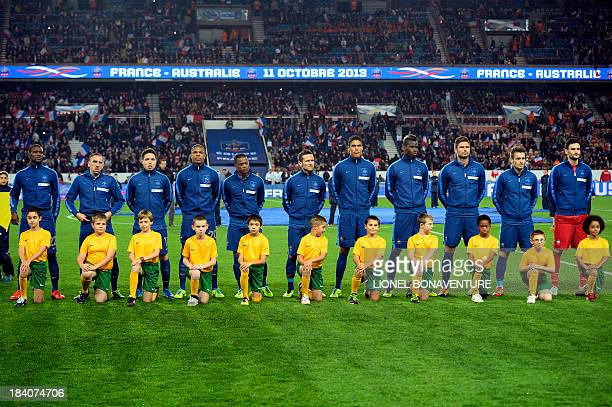 French national football team's players pose with children prior to the friendly football match France vs Australia on October 11 2013 at the Parc...