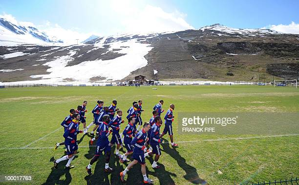French national football team's players run during a training session on May 20 2010 in Tignes French Alps as part of their altitude training in...