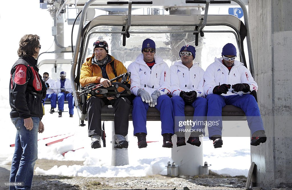 French national football team's players Yoann Gourcuff (3rdL), press officer Francois Manardo (C) and Thierry Henry (R) sit on a ski lift upon their arrival in Tignes, French Alps, on May 20, 2010 after having spent the night with teammates at the top of the Tignes glacier, as part of their altitude training in preparation for the 2010 World cup in South Africa.