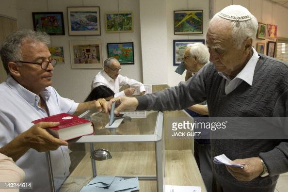A French national living in Israel casts his ballot for the French presidential elections at a polling station in the Israeli town of Netanya north...