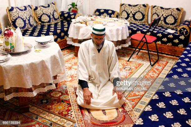 French national Mbirik offers prayers after breaking his fast during the Islamic holy month of Ramadan in Les Ulis southwest of Paris on June 11 as...