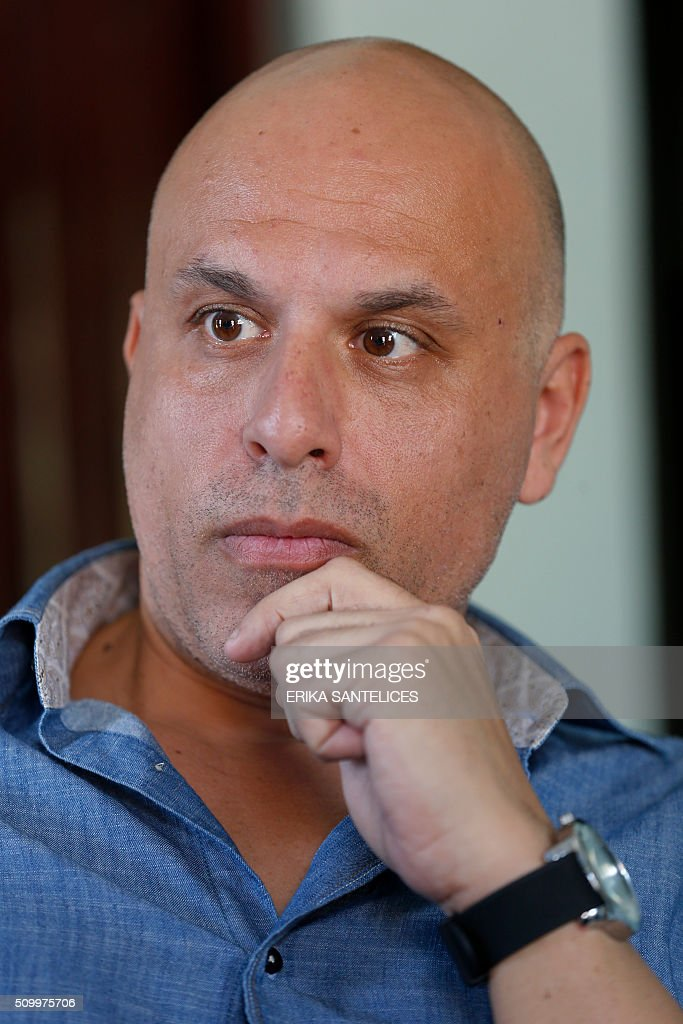 French national Nicolas Pisapia, accused of trying to fly dozens of suitcases packed with cocaine from the Dominican Republic to France, gestures during an interview in the office of his Dominican lawyer Andy De Leon in Higuey, Altagracia province, Dominican Republic on February 13, 2016. Pisapia was arrested with French nationals Alain Castany, pilot Pascal Fauret and co-pilot Bruno Odos in March 2013 as they were about to take off from the Dominican resort of Punta Cana in a case dubbed 'Air Cocaine' in France. AFP PHOTO / ERIKA SANTELICES / AFP / ERIKA SANTELICES