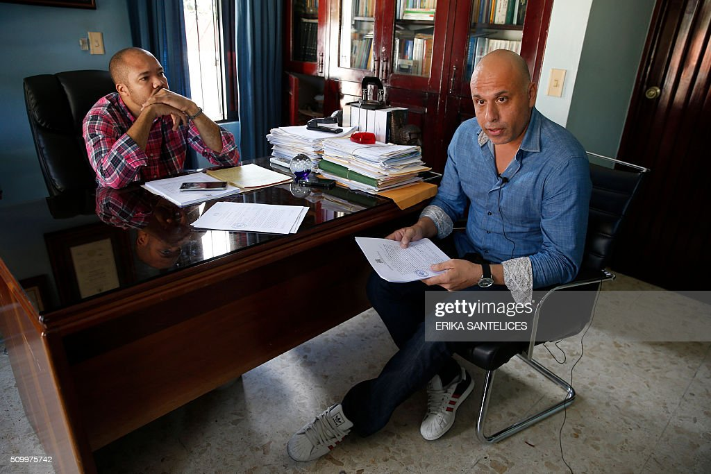 French national Nicolas Pisapia (R), accused of trying to fly dozens of suitcases packed with cocaine from the Dominican Republic to France, during an interview in the office of his Dominican lawyer Andy De Leon in Higuey, Altagracia province, Dominican Republic on February 13, 2016. Pisapia was arrested with French nationals Alain Castany, pilot Pascal Fauret and co-pilot Bruno Odos in March 2013 as they were about to take off from the Dominican resort of Punta Cana in a case dubbed 'Air Cocaine' in France. AFP PHOTO / ERIKA SANTELICES / AFP / ERIKA SANTELICES