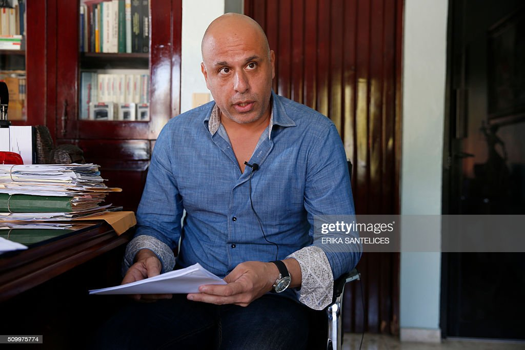 French national Nicolas Pisapia, accused of trying to fly dozens of suitcases packed with cocaine from the Dominican Republic to France, speaks during an interview in the office of his Dominican lawyer Andy De Leon in Higuey, Altagracia province, Dominican Republic on February 13, 2016. Pisapia was arrested with French nationals Alain Castany, pilot Pascal Fauret and co-pilot Bruno Odos in March 2013 as they were about to take off from the Dominican resort of Punta Cana in a case dubbed 'Air Cocaine' in France. AFP PHOTO / ERIKA SANTELICES / AFP / ERIKA SANTELICES