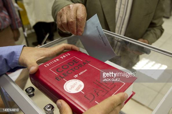 A French national residing in Israel casts his ballot for the French presidential elections at a polling station in the Israeli town of Netanya at...