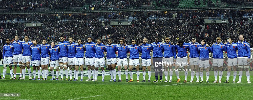 French national rugby team players listen to the national hymn before the Six Nations Rugby Union match France-Scotland at the Stade de France, in Saint-Denis, near Paris on March 16, 13. AFP PHOTO / LIONEL BONAVENTURE