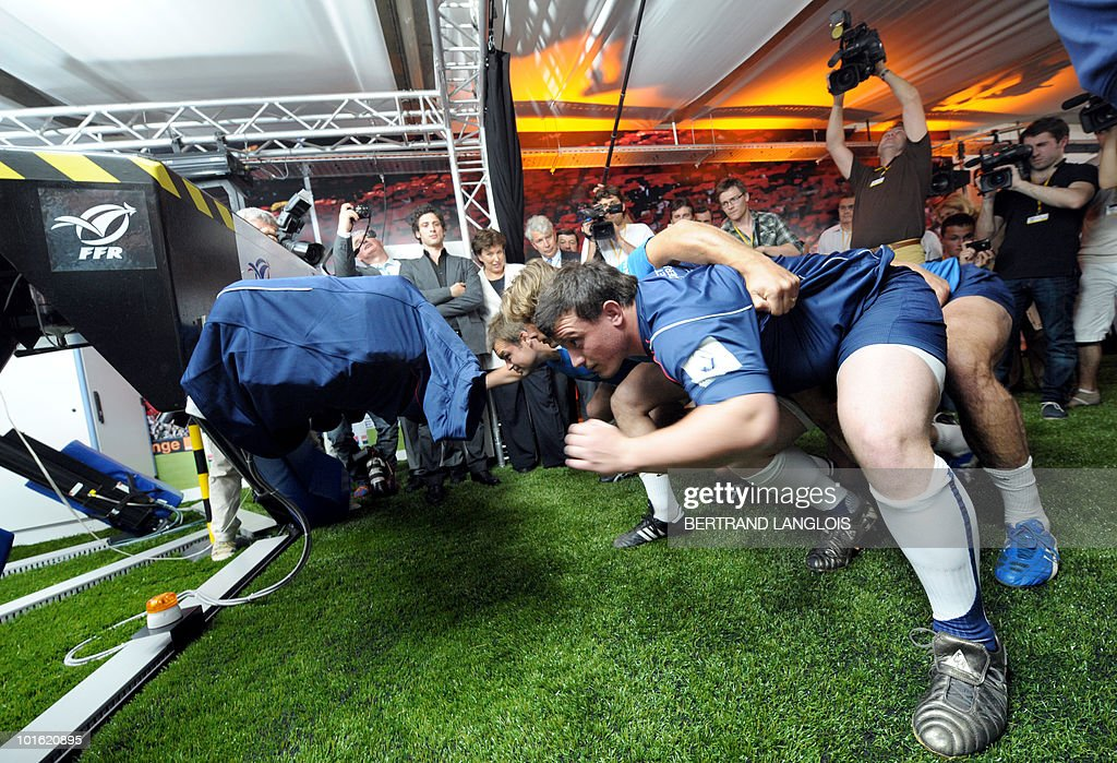 French national rugby union team prop Thomas Domingo (foreground) takes part in the first time use of a scrum simulator by France's rugby union national team, on June 4, 2010 in Marcoussis, near Paris. This simulator is a scientific and technological revolution which allows for more security of the players and at the same time enhances their performance.