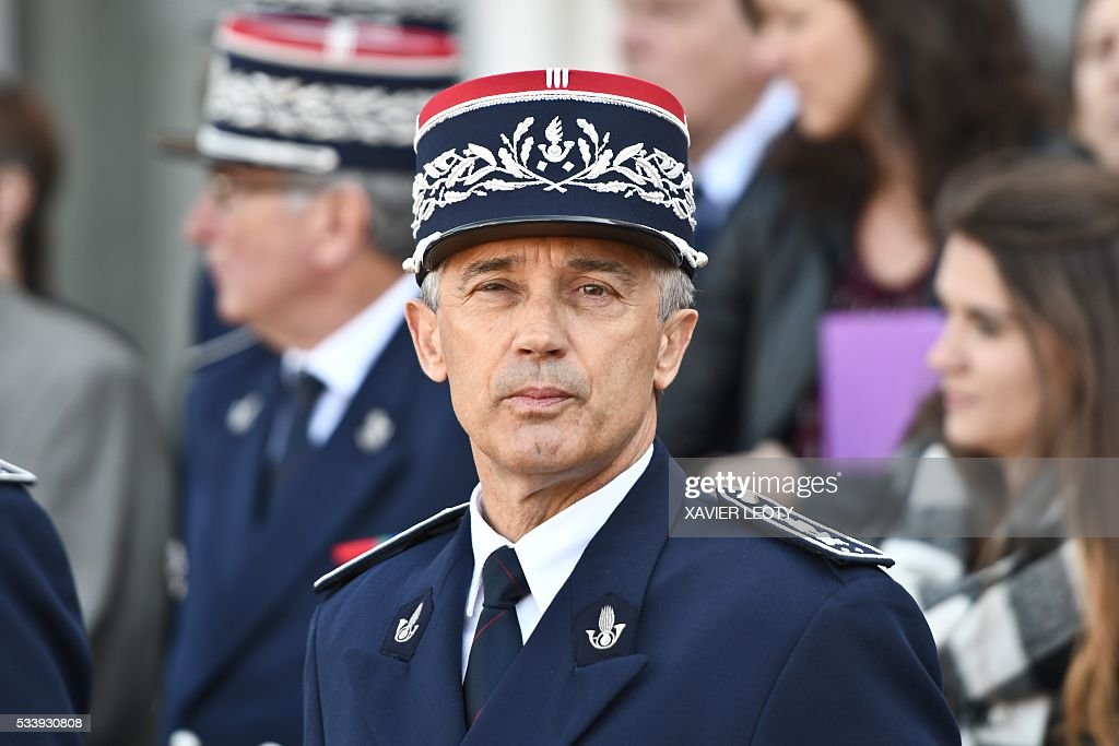French National School of Customs Director Pierre Rideau looks on during the closing ceremony for the graduated class of the National School of Customs in La Rochelle on May 24, 2016. French customs services received a new training to fight against terrorism, the first 'agents of observation' of customs recruited as part of the security agreement to reinforce the numbers of judiciary, penitentiary and customs police and gendarme members. As part of this security agreement and concerning only the customs service 1,000 new positions will be created between 2016 and 2017. / AFP / XAVIER