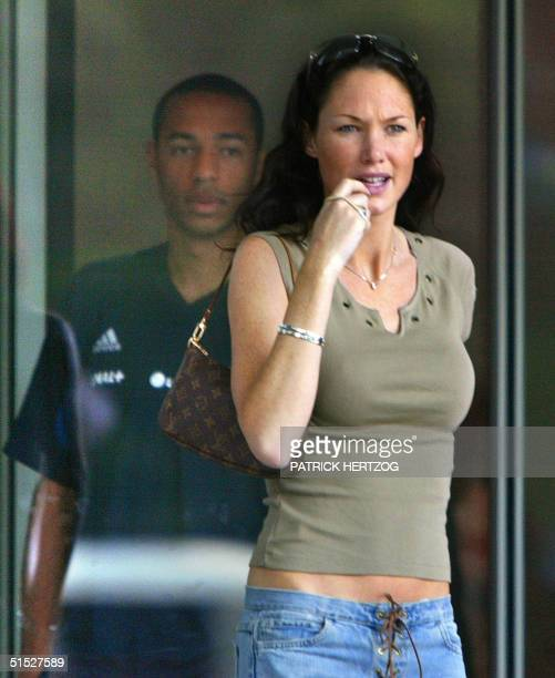 French national soccer team player Thierry Henry and his girlfriend Claire leave the Sheraton Hotel 02 June 2002 in Seoul after a lunch with the...