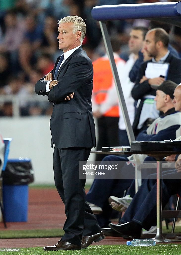 French national soccer team's coach Didier Deschamps looks at his players during the FIFA World Cup 2014 qualifying football match Georgia vs France on September 6 2013 at the Boris Paichadze stadium in Tbilisi.