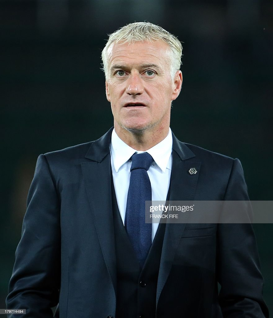 French national soccer team's coach Didier Deschamps looks at his players warming up prior to the FIFA World Cup 2014 qualifying football match Georgia vs France on September 6 2013 at the Boris Paichadze stadium in Tbilisi. AFP PHOTO / FRANCK FIFE