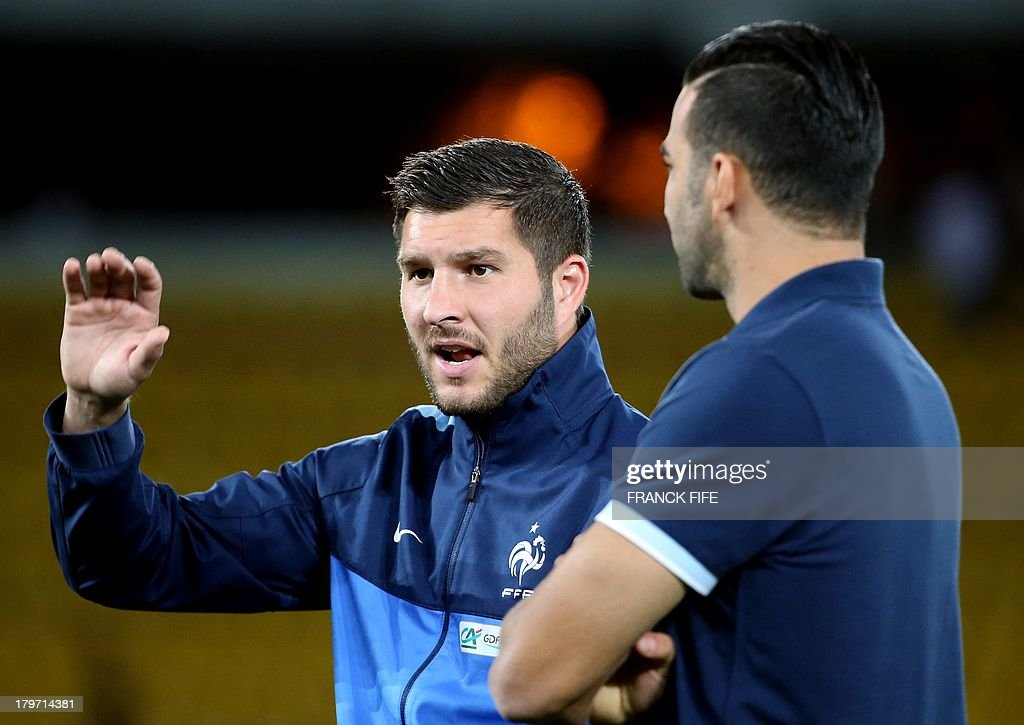 French national soccer team's forward Andre-Pierre Gignac gestures next to defender Adil Rami prior to the FIFA World Cup 2014 qualifying football match Georgia vs France on September 6 2013 at the Boris Paichadze stadium in Tbilisi.