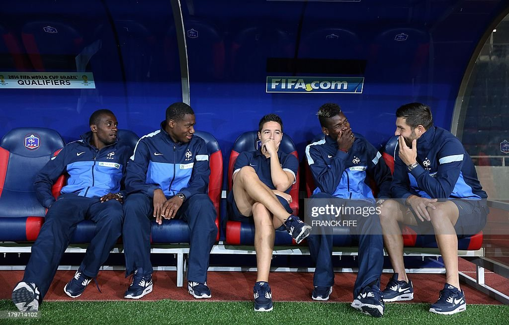 French national soccer team's midfielder Blaise Matuidi, midfielder Moussa Sissoko, midfielder Samir Nasri, midfielder Paul Pogba and forward Andre-Pierre Gignac are pictured on the bench before the FIFA World Cup 2014 qualifying football match Georgia vs France on September 6 2013 at the Boris Paichadze stadium in Tbilisi.