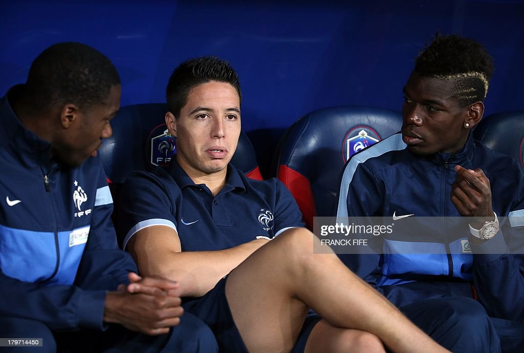French national soccer team's midfielder Samir Nasri (C) speaks with France's midfielder Moussa Sissoko (L) and midfielder Paul Pogba before the FIFA World Cup 2014 qualifying football match Georgia vs France on September 6 2013 at the Boris Paichadze stadium in Tbilisi.