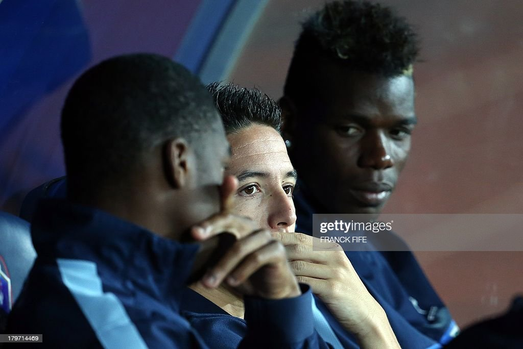 French national soccer team's midfielder Samir Nasri (C) speaks with France's midfielder Moussa Sissoko (L) and midfielder Paul Pogba before the FIFA World Cup 2014 qualifying football match Georgia vs France on September 6 2013 at the Boris Paichadze stadium in Tbilisi. AFP PHOTO / FRANCK FIFE
