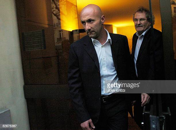 French national team and Marseille goalkeeper Fabien Barthez leaves 21 April 2005 the French football federation headquarters in Paris for a hearing...