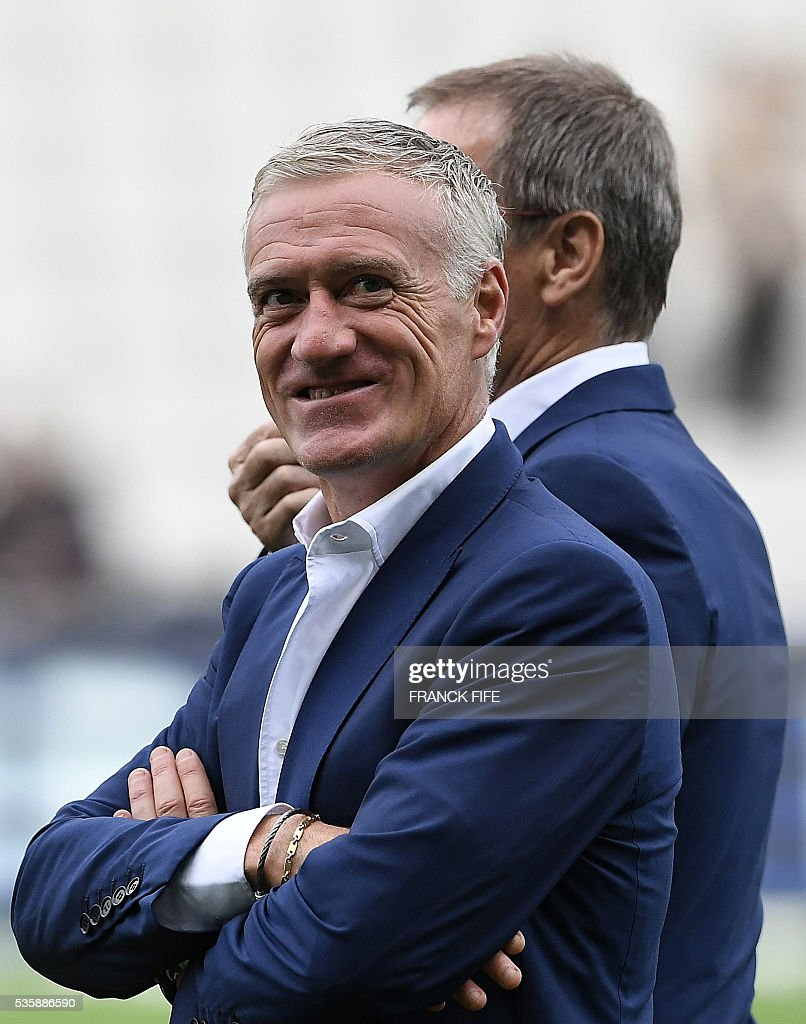 French national team head coach Didier Deschamps smiles prior to the friendly football match between France and Cameroon, at the Beaujoire Stadium in Nantes, western France, on May 30, 2016. / AFP / FRANCK