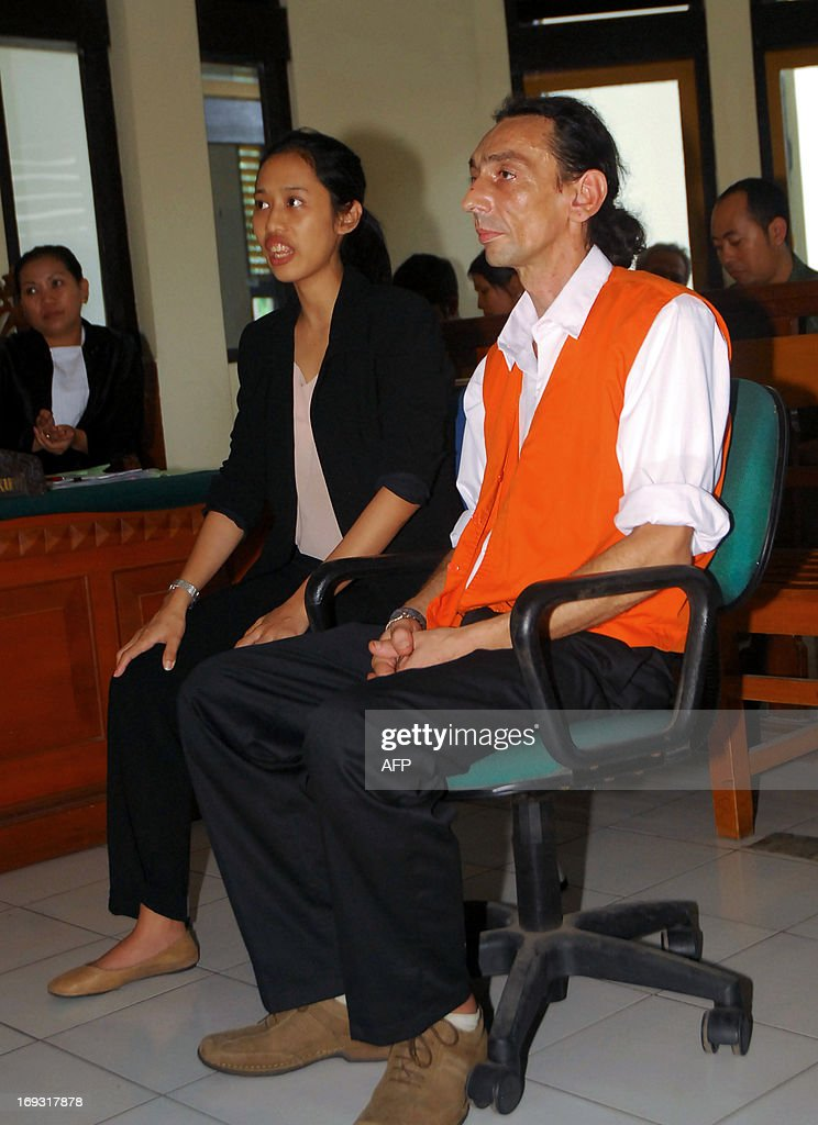 French national Vincent Roger Petrone (R) testifies in court accompanied by an interpreter during a trial in Denpasar on Indonesia's island of Bali on May 23, 2013. Petrone was arrested at Bali's airport on January 29, 2013 after he was detected of hiding four capsules of hashish weighing 69 grammes (2.4 ounces) in his intestine following his arrival from Kuala Lumpur. If convicted of smuggling the drugs into Indonesia, Petrone could face the death penalty.