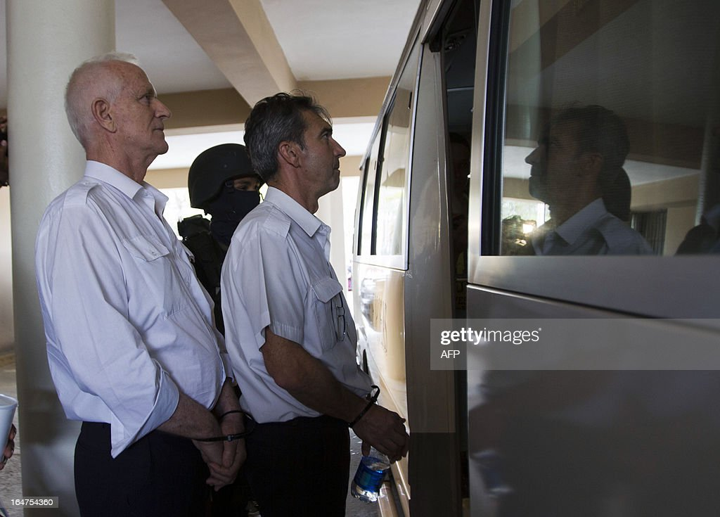French nationals Alain Marc Castany (L) and Bruno Armand Victor leave after an audience to judge the case of four French citizens accused of drug trafficking in Santo Domingo, on March 27, 2013. A Dominican court postponed until April 4 the session to deal with the case of the four defendants, charged with attempt to smuggle 700 kg of cocaine aboard an aircraft belonging to French businessman Alain Afflelou seized on March 20 when it was ready to fly to France. AFP PHOTO/ERIKA SANTELICES