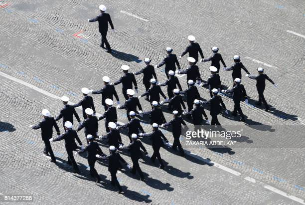 TOPSHOT French navy officers march during the annual Bastille Day military parade on the ChampsElysees avenue in Paris on July 14 2017 The parade on...