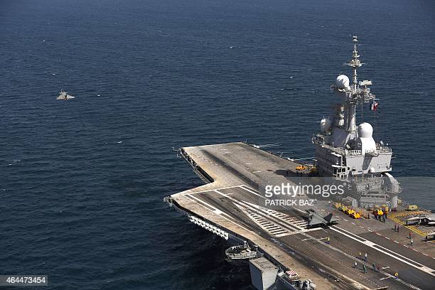A French navy Rafale fighter jet takes off from the aircaft carrier Charles de Gaulle operating in the Gulf on February 26 2015 French warplanes...