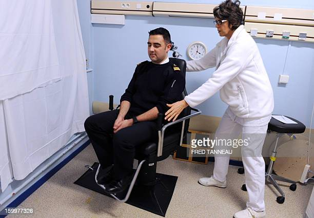 French Navy seaman completes reeducation with a nurse on January 17 2013 at the Ear Nose and Throat unit in Brest's French Army Hospital western...