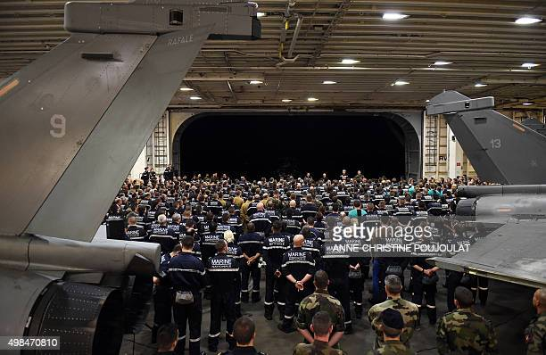 French navy soldiers listen to French Army Chief of Staff General Pierre de Villiers on the French CharlesdeGaulle aircraft carrier on November 23...